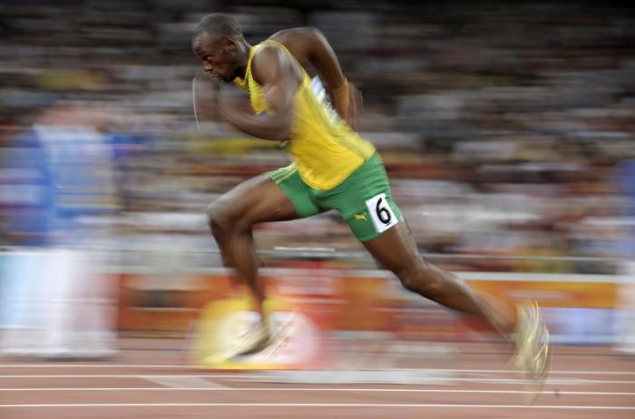 Usain Bolt compitiendo en los JJOO de Beijing