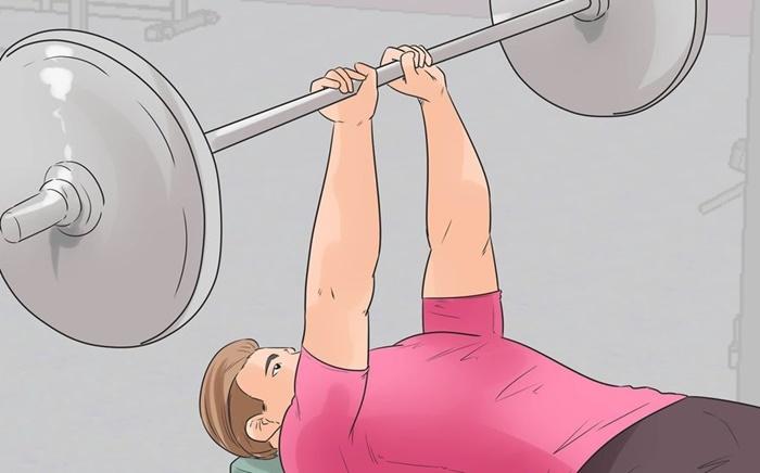 Press de tríceps con barra en banco