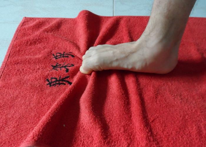 Arrugar toalla